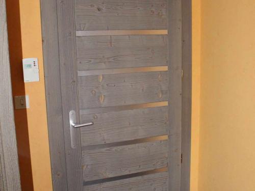 Porte sapin teinté avec insert aluminium.jpg
